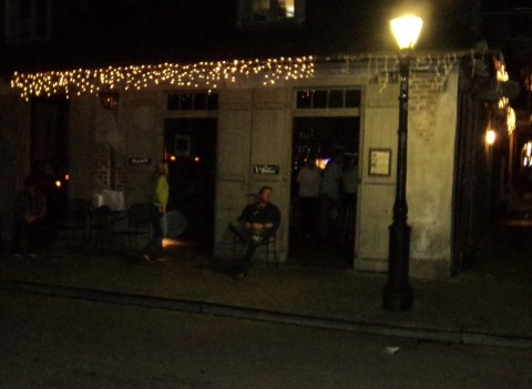 That's me sitting under the street light outside America's oldest pub
